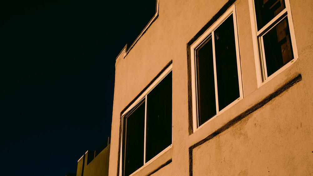 san diego wedding   photographer | building with open windows against sunlight
