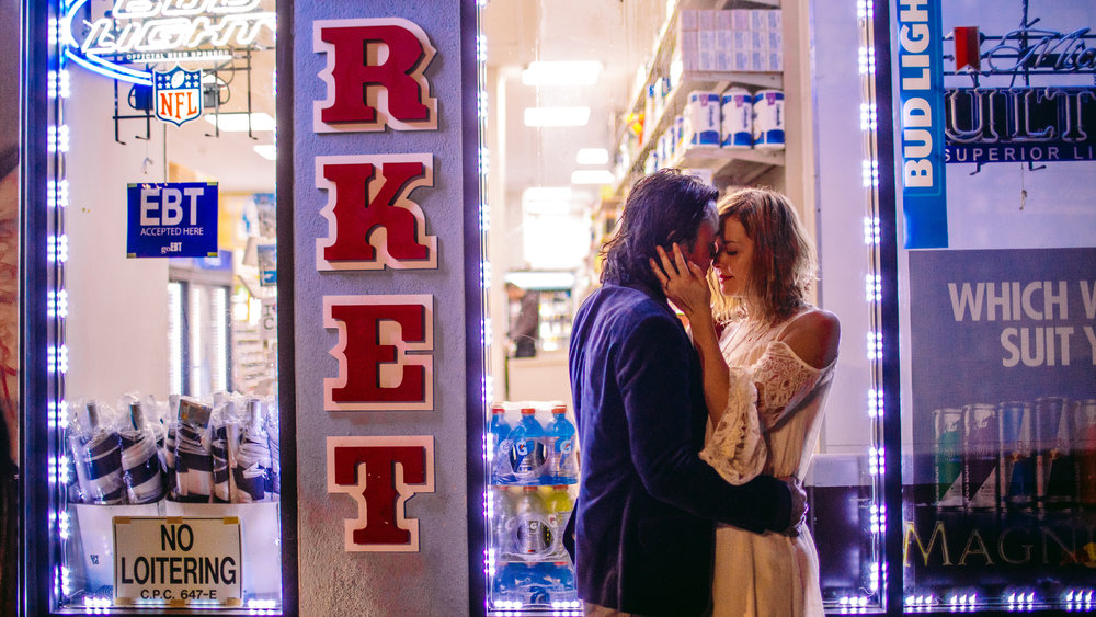 san diego wedding   photographer | couple about to kiss with man's hand on woman's waist in   doorway of market