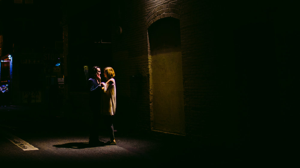 san diego wedding   photographer | couple standing under streetlight with woman's hand on man's   face