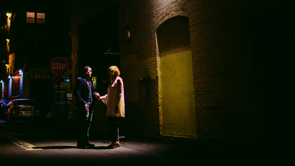 san diego wedding   photographer | couple standing under streetlight holding hands in the night