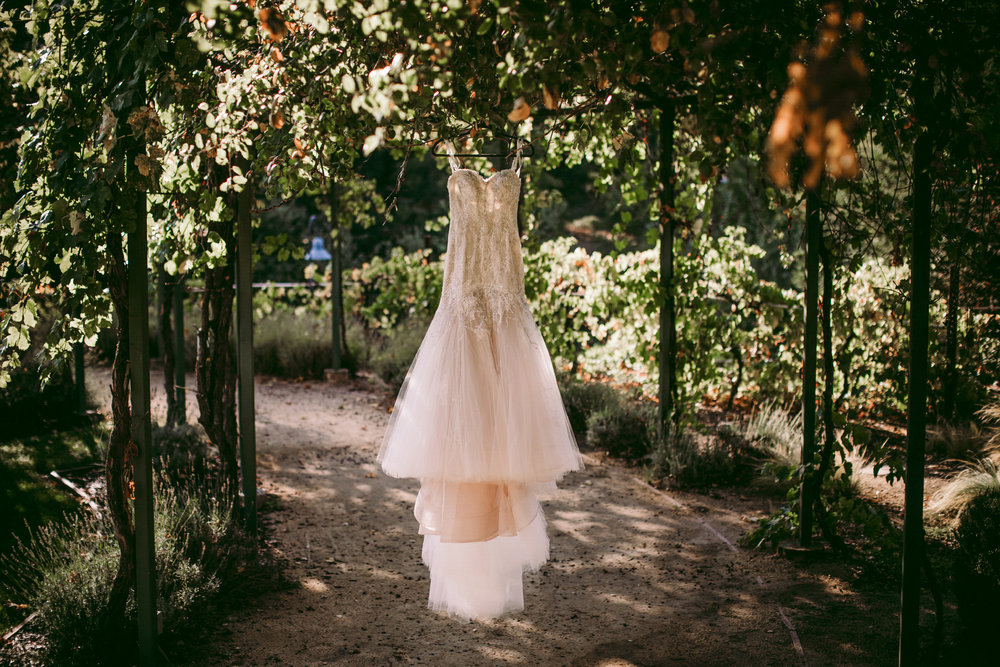 san diego wedding   photographer | wedding dress hanging in the middle of a walkway