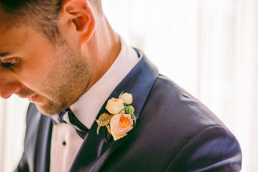 san diego wedding   photographer | man in suit attached with flowers looking down