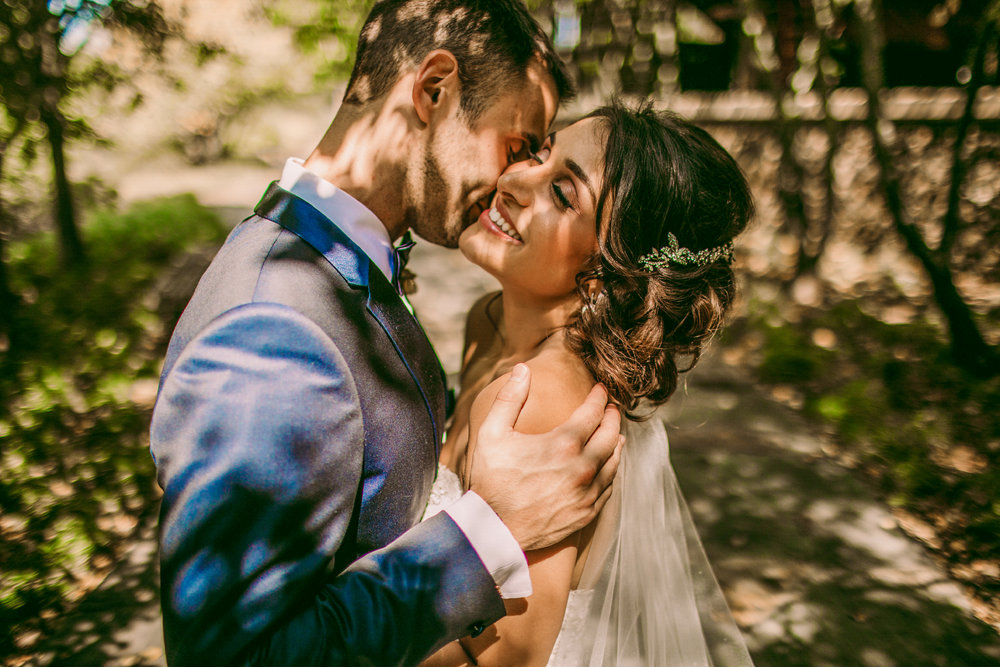 san diego wedding   photographer | man kissing woman's cheek while holding her shoulder