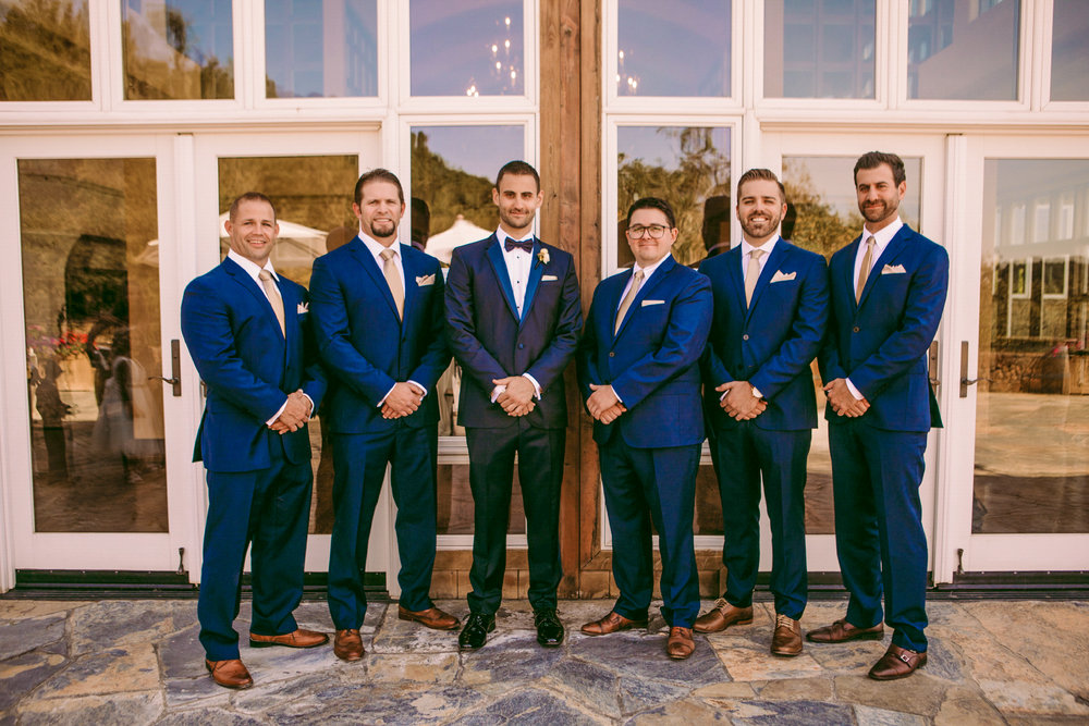 san diego wedding   photographer | group of men in blue suits standing in front of building with   glass windows