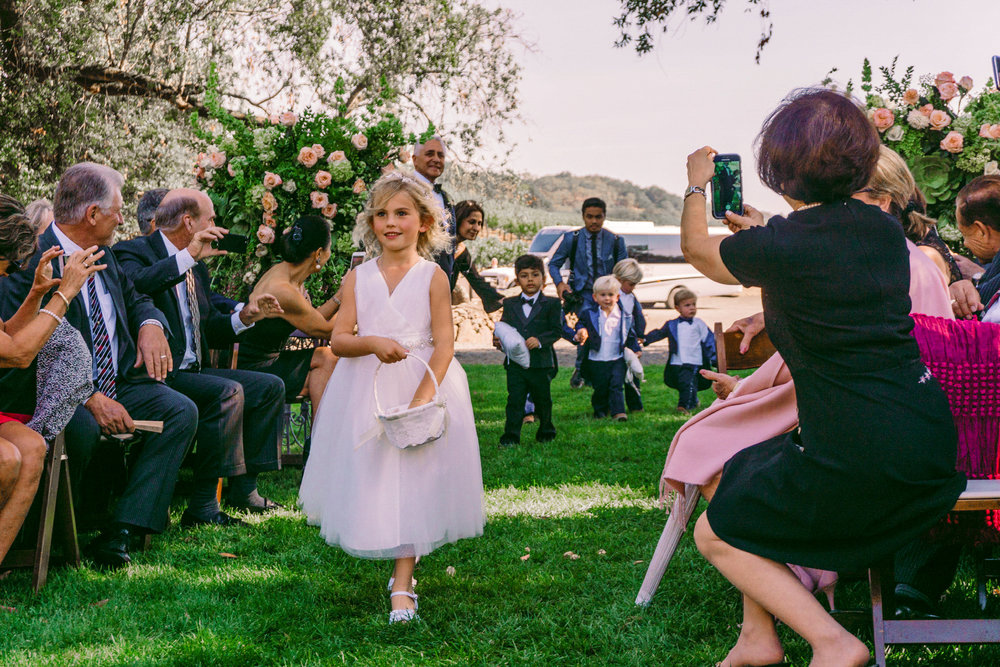 san diego wedding   photographer | children walking down the line following flower girl