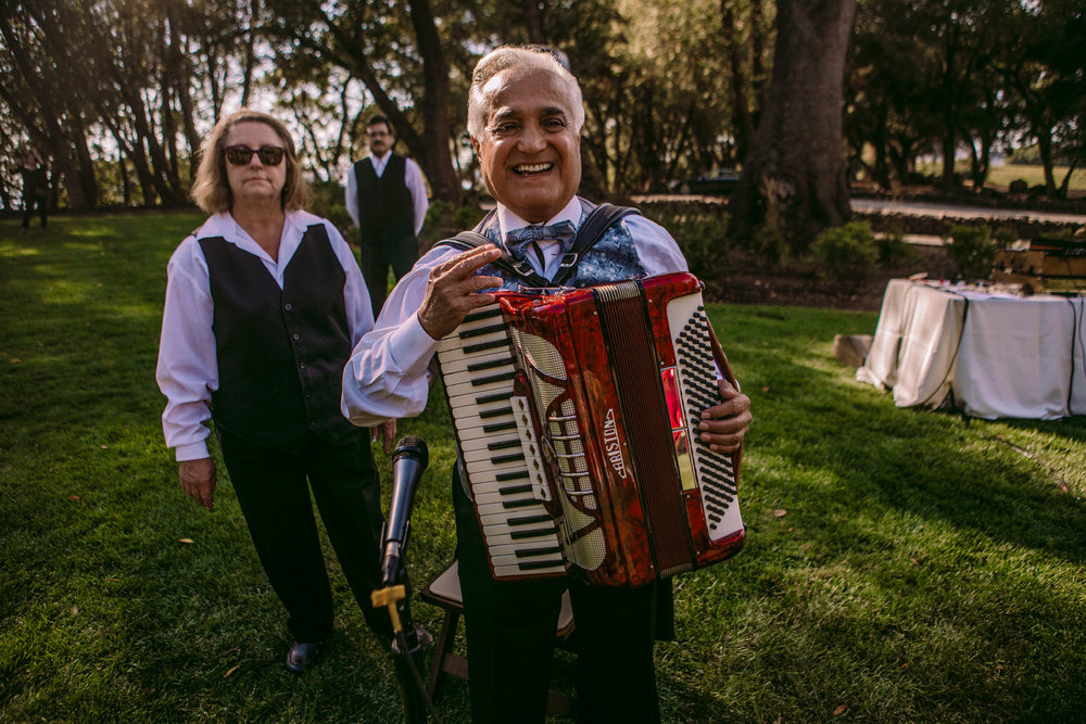 san diego wedding   photographer | man with accordion laughing