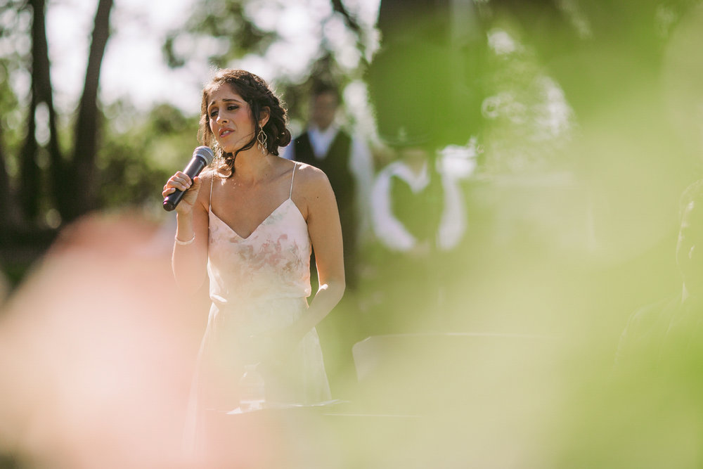 san diego wedding   photographer | woman in dress speaking with a mic in her hand