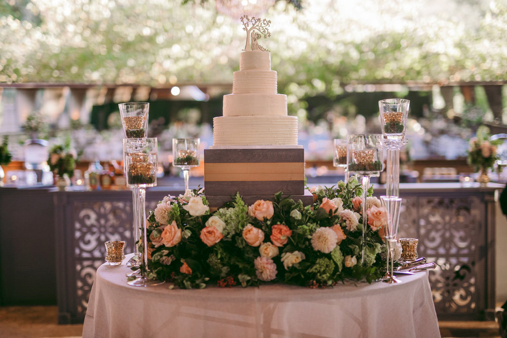 san diego wedding   photographer | white wedding cake surrounded by flowers