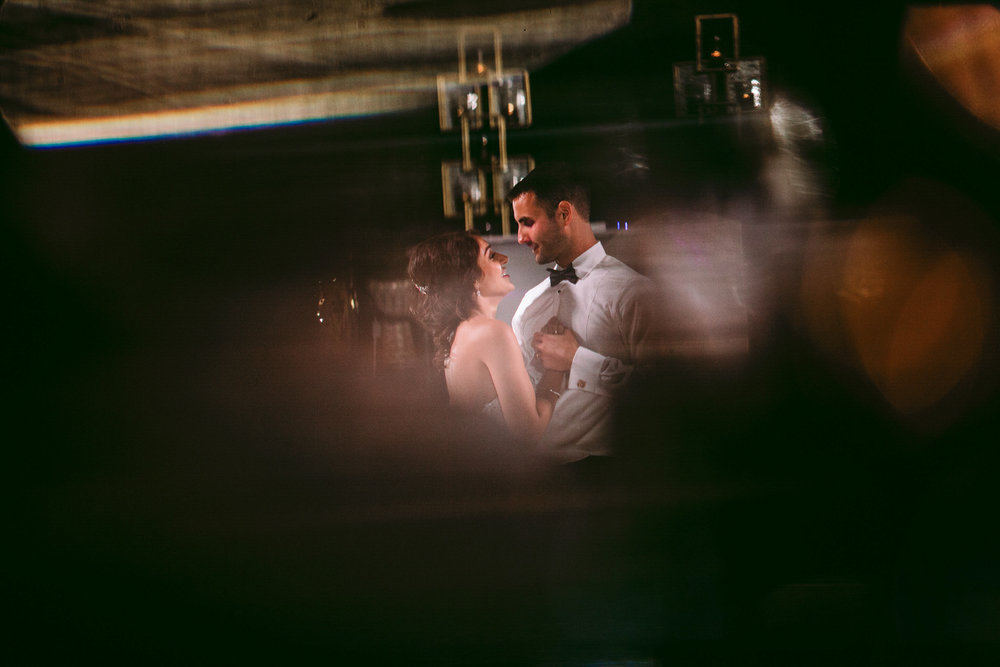 san diego wedding   photographer | married couple dancing while groom holds brides hand while   looking into each other's eyes