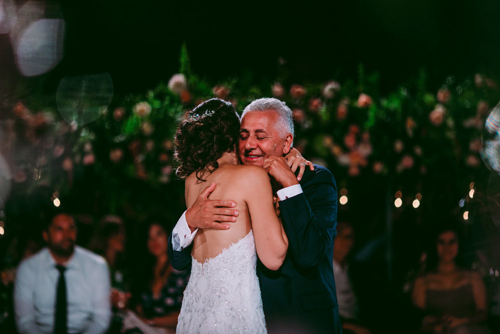 san diego wedding   photographer | bride hugging old man while old man is smiling