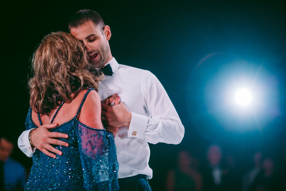 san diego wedding   photographer | groom dancing with woman in blue dress while groom holds   woman's back