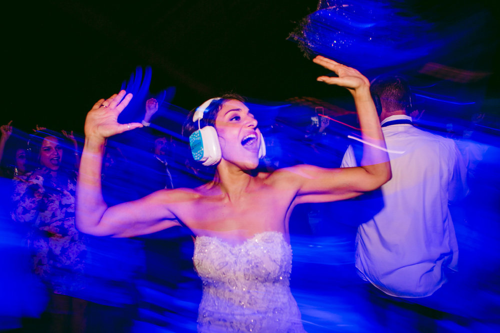 san diego wedding   photographer | bride wearing noise canceling headphones while dancing