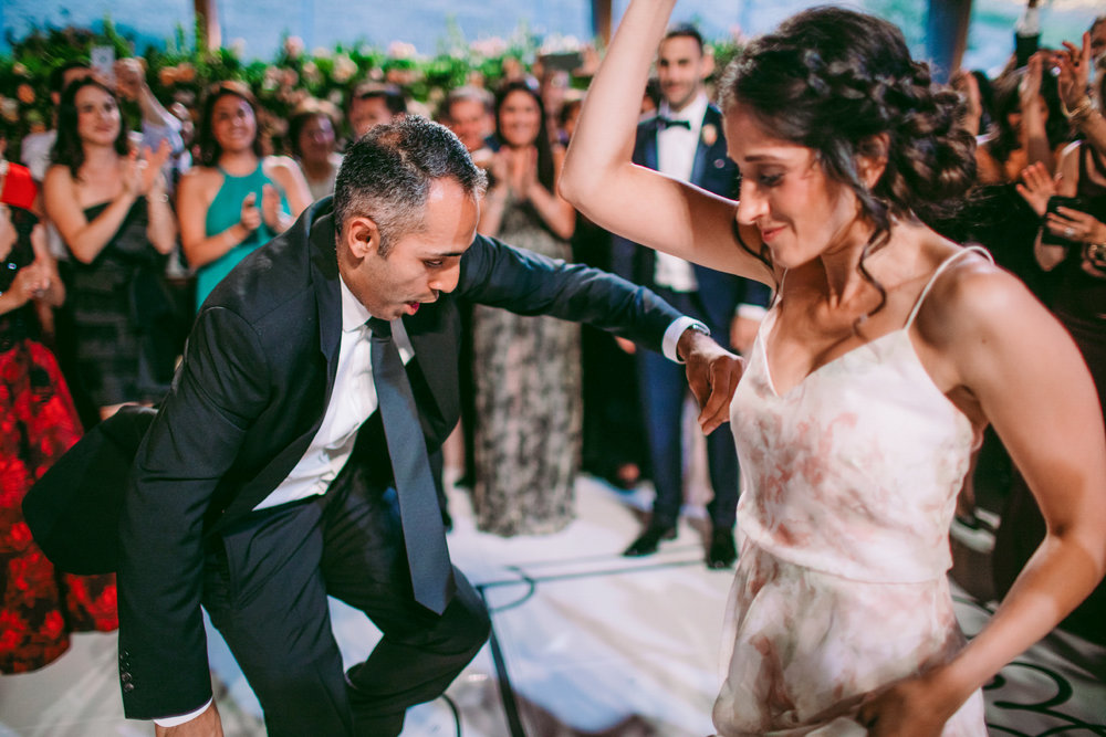 san diego wedding   photographer | bride dancing with man in suit with crowd in background
