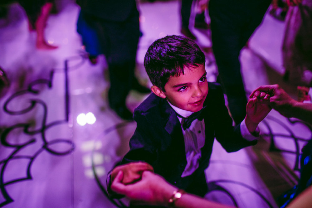 san diego wedding   photographer | child dancing while looking up in the middle of the dance   floor