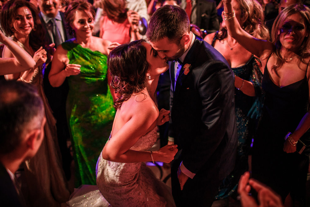 san diego wedding   photographer | married couple kissing in the middle of dance floor surrounded   by crowd