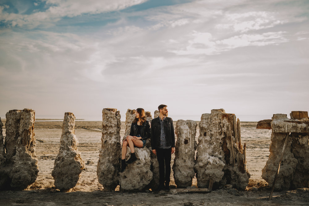 san diego wedding   photographer | woman sitting on sand formation beside man while they look at   different directions