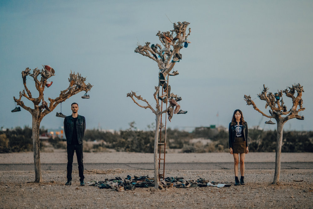 san diego wedding   photographer | couple stands between 3 dead trees surrounded by discarded   shoes
