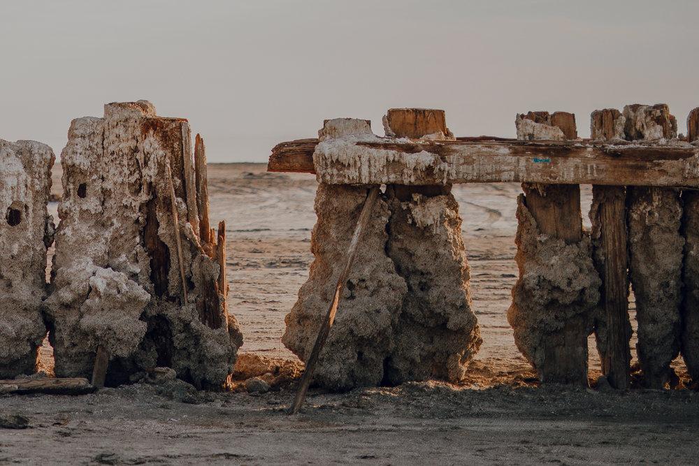 san diego wedding   photographer | broken wooden fence with accumulating sand
