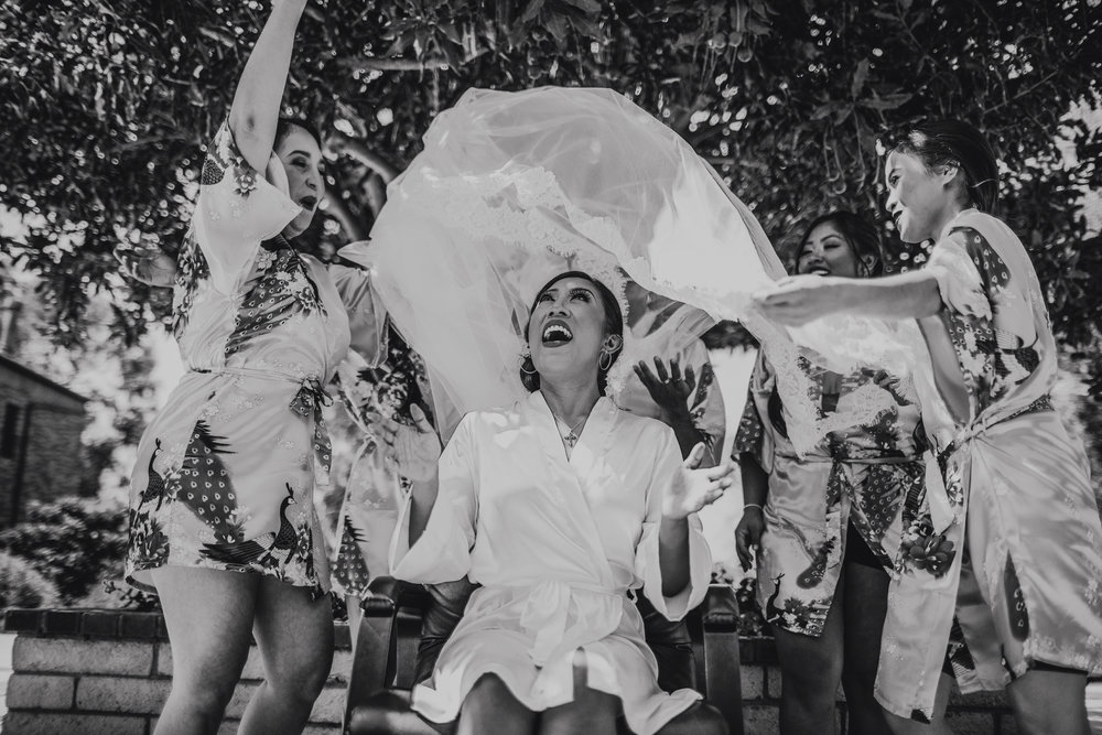 San Diego Wedding Photographer | bride putting her vail on