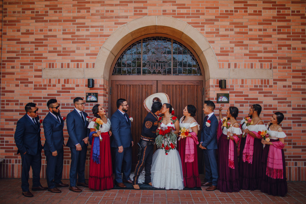 San Diego Wedding Photographer | bride and groom kissing with bridal party
