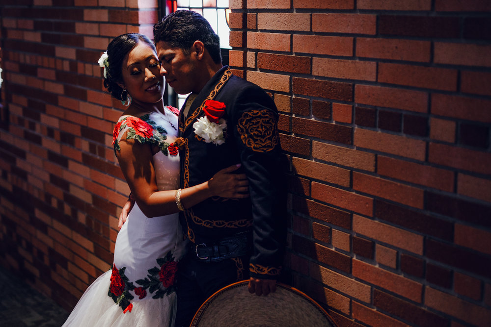 San Diego Wedding Photographer | bride and groom posing inside of Torrey pines church