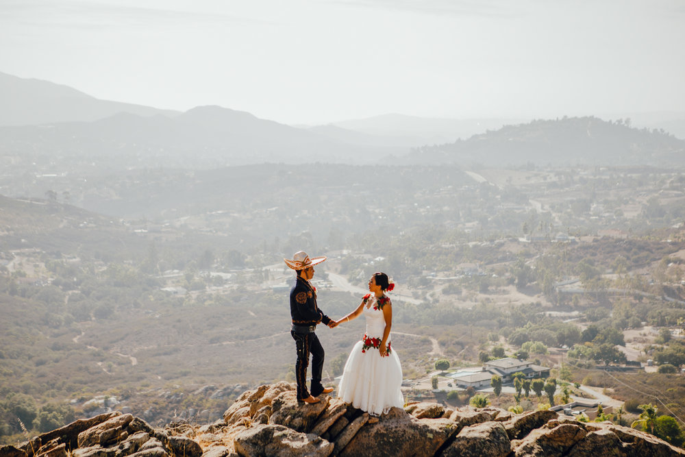 San Diego Wedding Photographer | couple posing at Montana Cielo over looking view