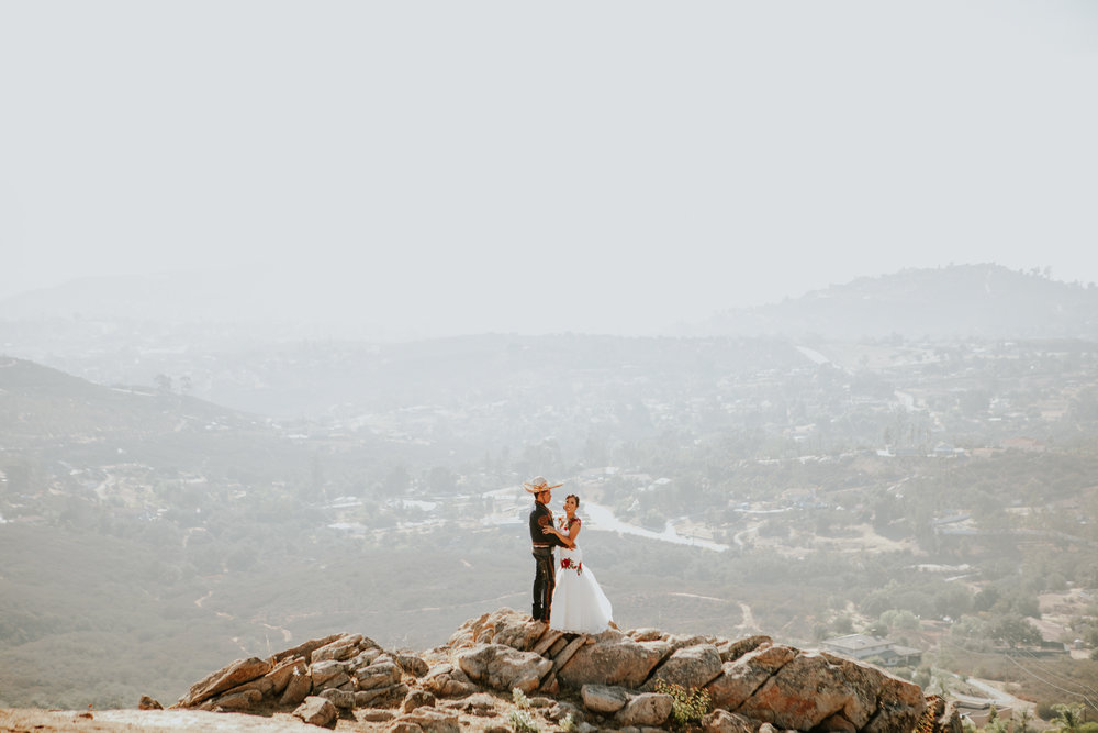 San Diego Wedding Photographer | wedding couple posing with a view of San Diego in Montana Cielo