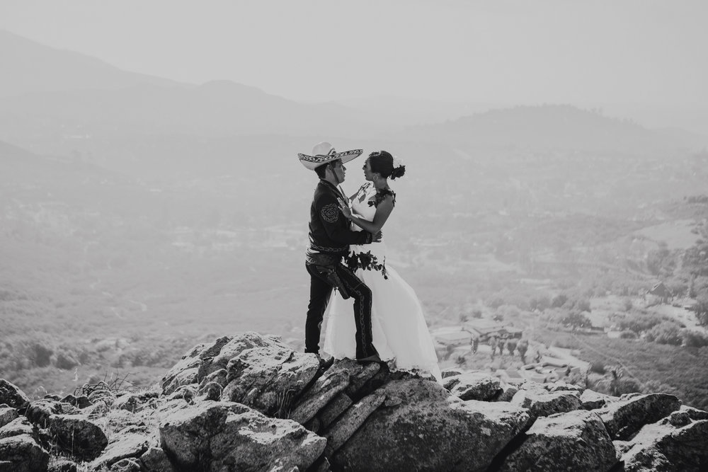 San Diego Wedding Photographer | wedding couple posing by rock formation