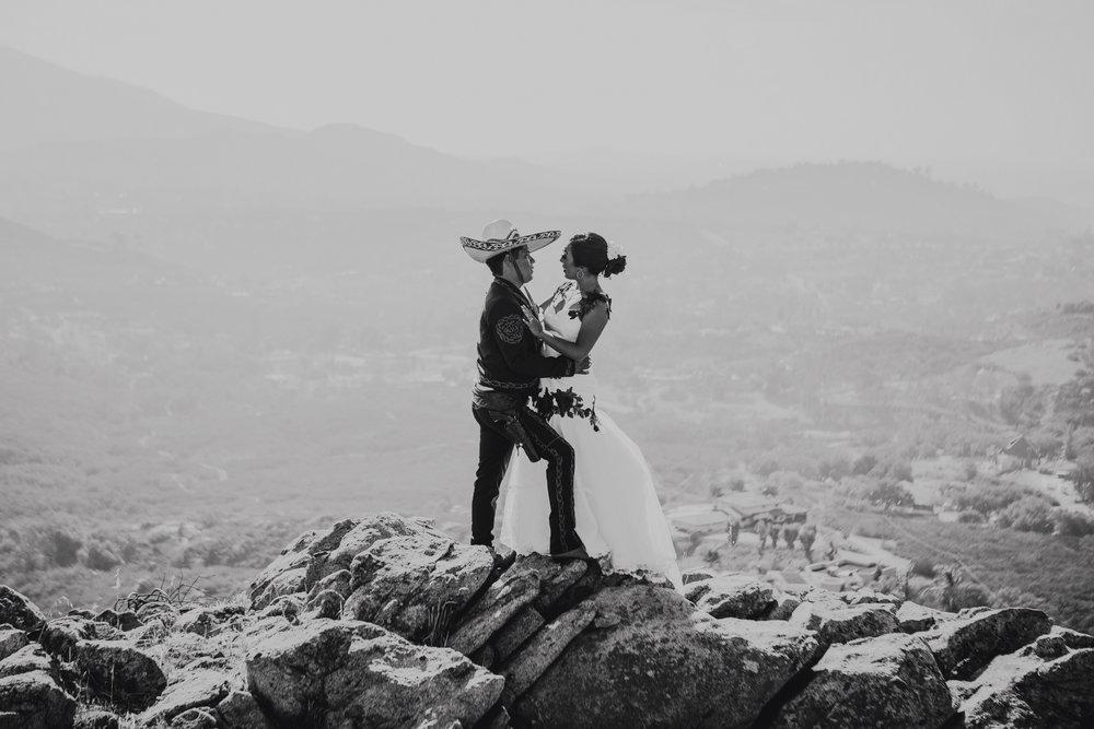 San Diego Wedding Photographer | wedding couple posing by rock formation
