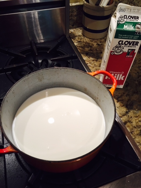 Start with pouring the milk into your pot. This pot is not metal: it has enamel over cast iron. That is okay!