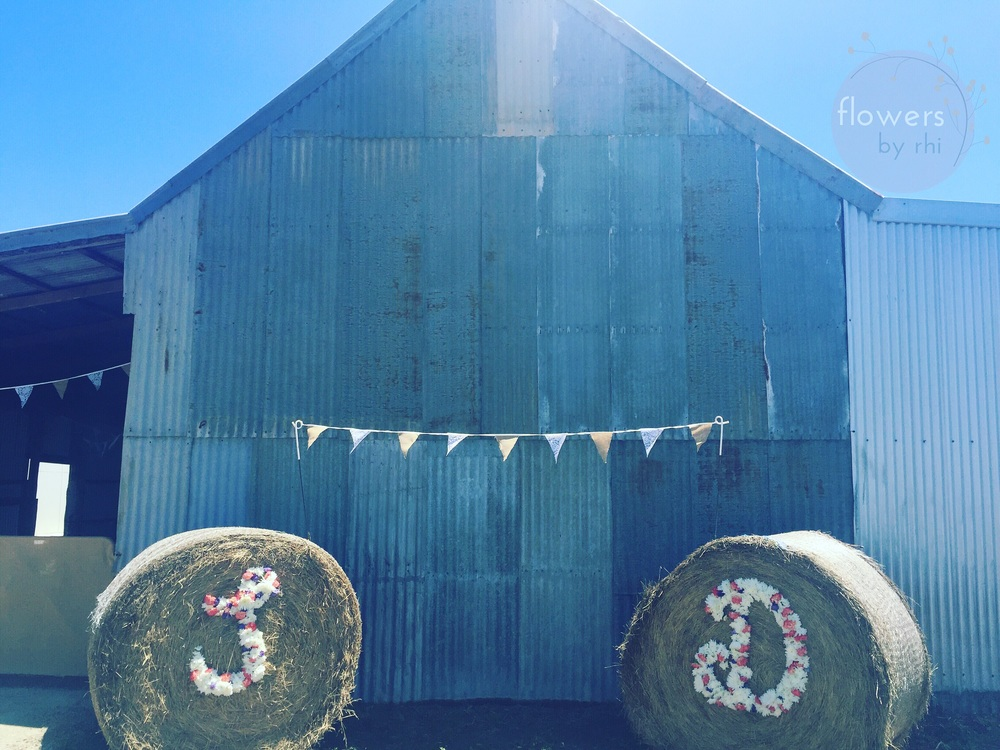 Large floral letters to decorate hay bales, perfect for a country wedding!