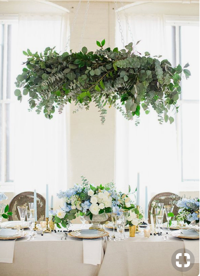 Image via Pinterest - it may be 'just greenery', but foliage is quite expensive and an arrangement like this is labour intensive - expect to spend a minimum of $300 on something of this size