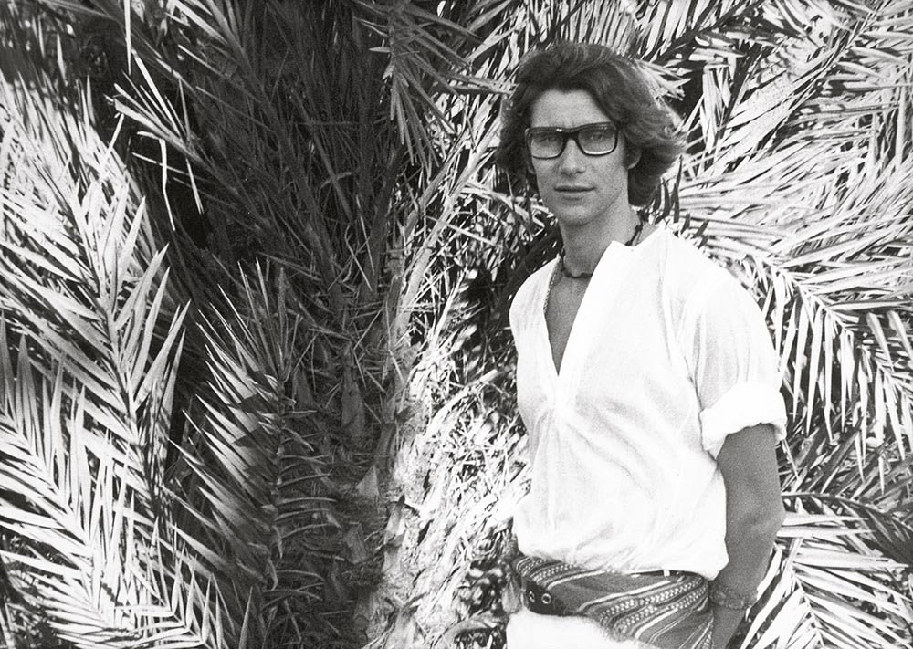 Yves Saint Laurent poses with the palms