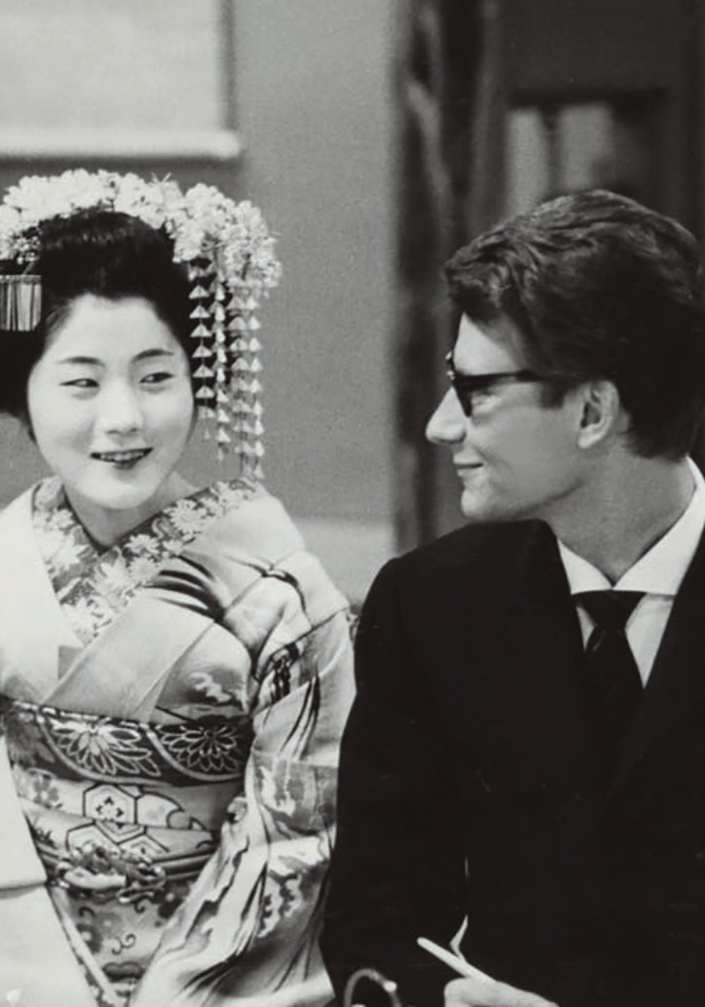 Yves Saint Laurent and a courtesan wearing traditional garments during the designer's first trip to Kyoto, Japan in April 1963