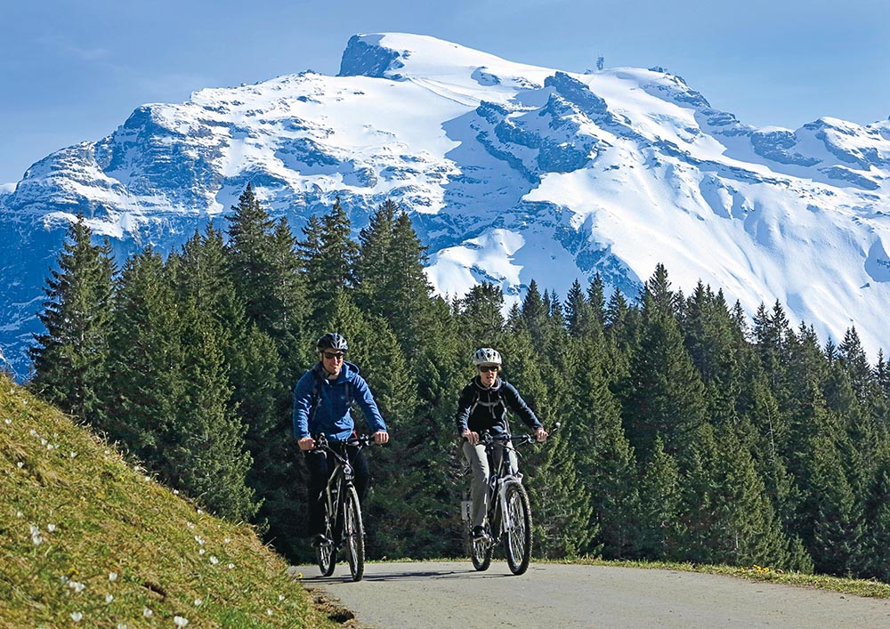 Riding e-bikes with a majestic Swiss backdrop