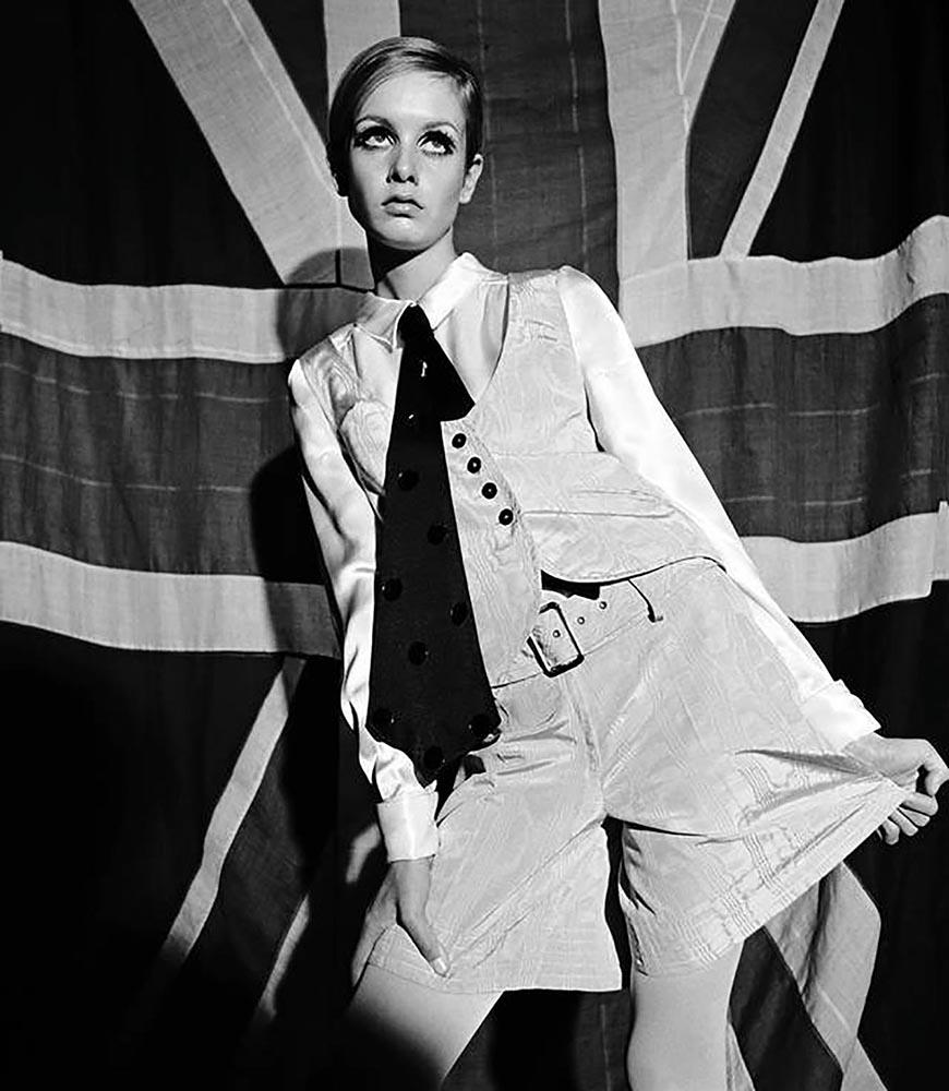 Twiggy wearing a moire taffeta waistcoat and skirt, 1966