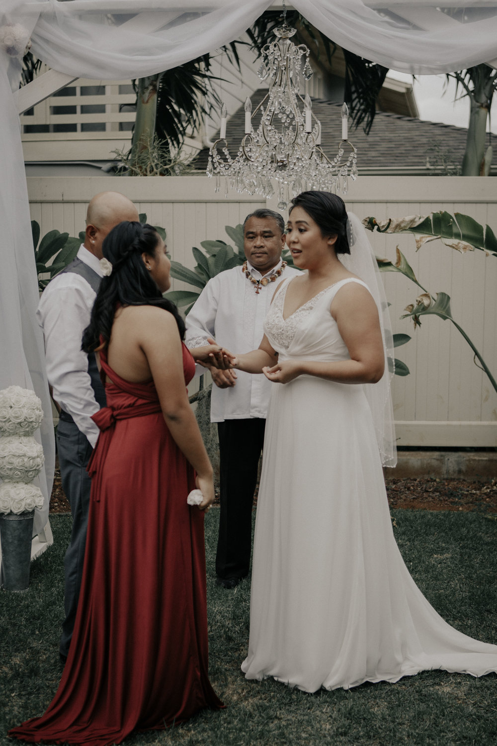 Bride making vows to the grooms daughter