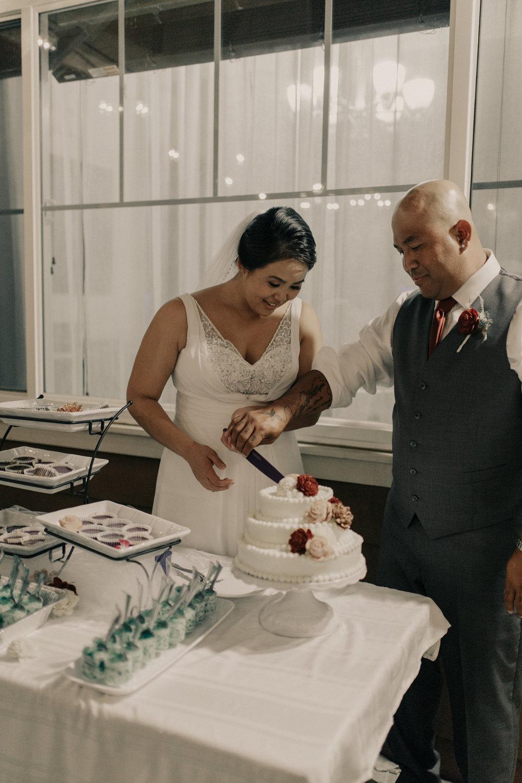 Cake cutting at a backyard wedding