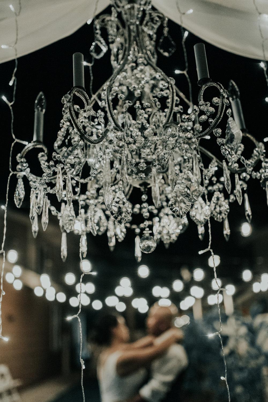 First dance under a chandelier