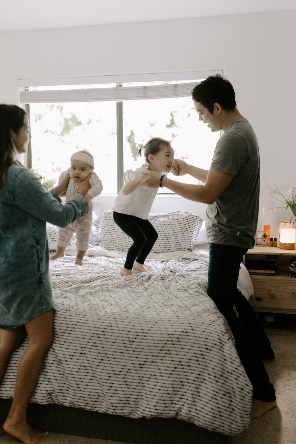 Family jumping on the bed