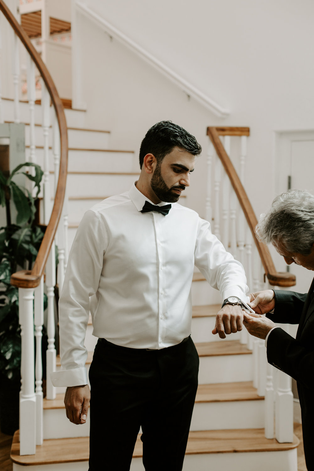 Father of groom helping him get ready