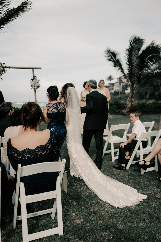 Parent's walking down bride down the aisle