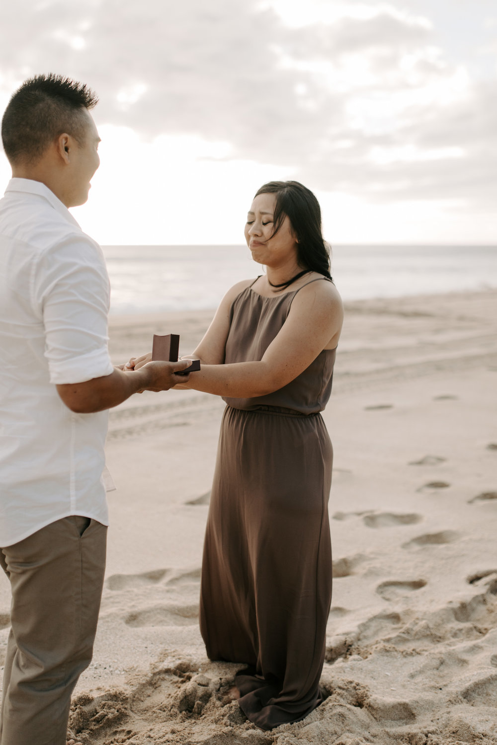 Surprise Proposal at Yokohama Bay by Oahu Wedding Photographer Desiree Leilani