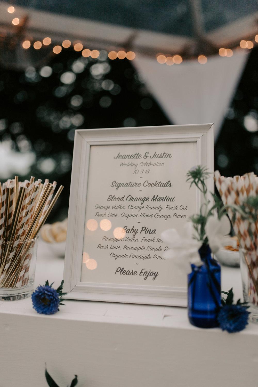 Custom wedding drink menu at Kualoa Ranch Paliku Gardens. Photography by Hawaii wedding photographer Desiree Leilani