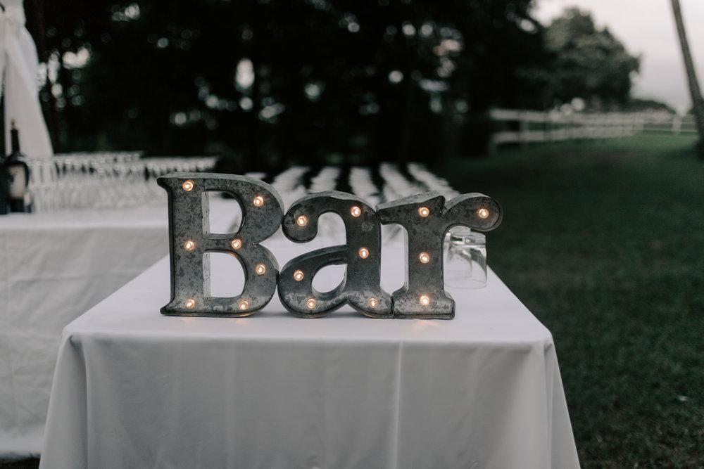 Cute bar set up at Kualoa Ranch Paliku Gardens. Photography by Hawaii wedding photographer Desiree Leilani