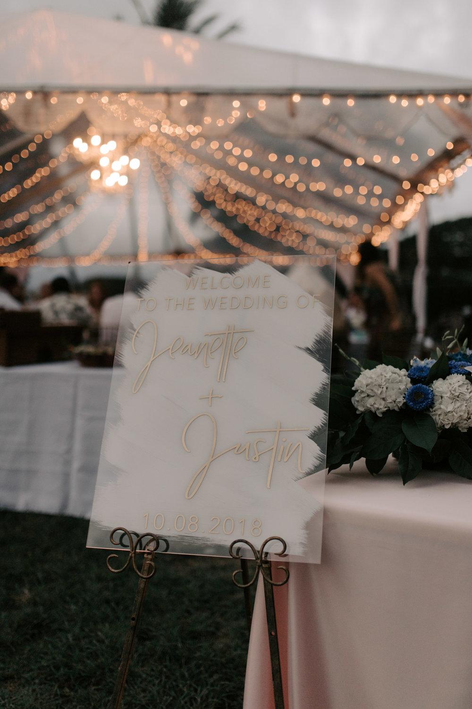 Beautiful gold custom wedding sign at Kualoa Ranch Paliku Gardens. Photography by Hawaii wedding photographer Desiree Leilani