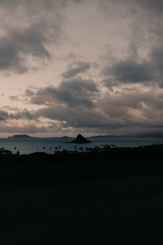 Sunset view of China Man's Hat from Kualoa Ranch Paliku Gardens. Photography by Hawaii fine art wedding photographer Desiree Leilani