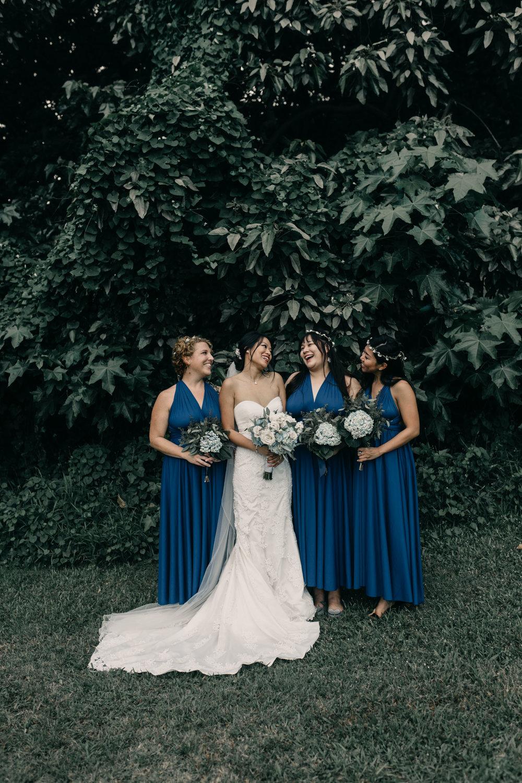 Bridesmaids laughing photo at Kualoa Ranch Paliku Gardens. Photography by Hawaii fine art wedding photographer Desiree Leilani