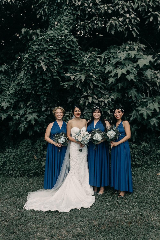 Blue bridesmaids dresses at Kualoa Ranch Paliku Gardens. Photography by Hawaii fine art wedding photographer Desiree Leilani