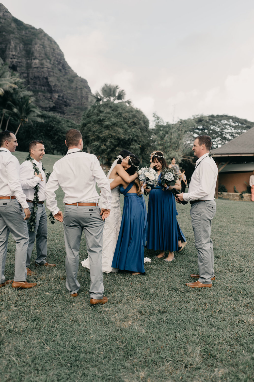 Emotional congratulations at Kualoa Ranch Paliku Gardens. Photography by Hawaii wedding photographer Desiree Leilani
